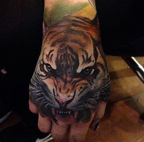 animal tattoo on hand tigers are one of earth s most beautiful and sadly