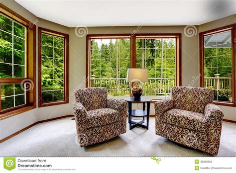 comfort sitters comfort sitting area with large french windows stock photo
