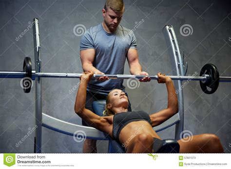 Barbel Sport and with barbell flexing muscles in stock photo image 57821073