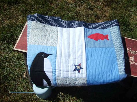 Blue Patchwork Throw - handmade penguin appliqued blue quilted throw blanket
