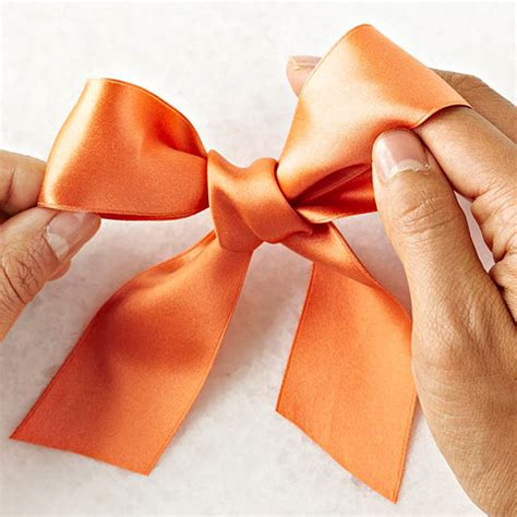 How To Make A Bow Out Of Wrapping Paper - make a classic bow in 4 easy steps