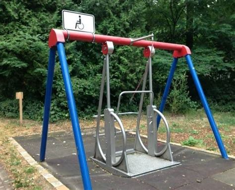 handicap swings a swing made for wheelchairs on a playground