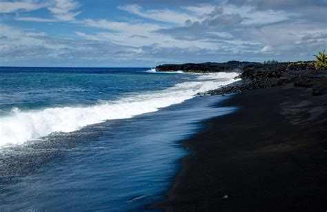 beach with black sand a darker shade of black everywhere once