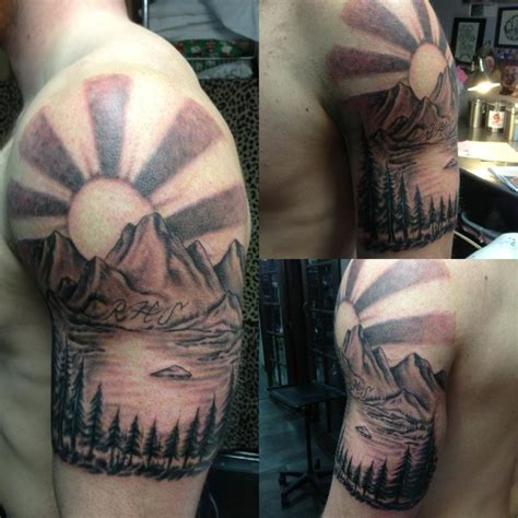 black and grey mountain scene tattoo by russell fortier at