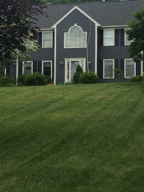 the color house sherwin williams peppercorn with downy white trim and