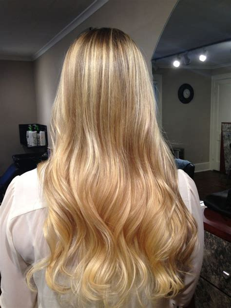 dark hair base with platinum highlights blonde balayage and blonde ombre with a dark blonde base