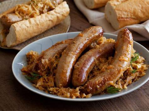 brats vs sausage bratwurst stewed with sauerkraut recipe michael symon