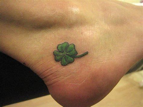 lovely small four leaf shamrock tattoo on below ankle