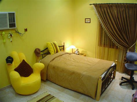 Bedroom Armchair Design Ideas Awesome Yellow Bedroom Decorating Ideas With Yellow Armchair Shaped Near Beds And