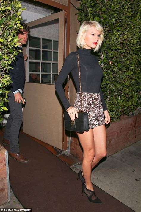 taylor swift cat heels taylor swift bares legs in cat print shorts and mesh heels