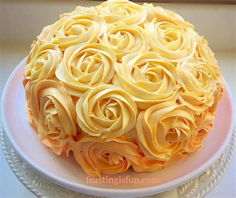 orange lemon ombre piped cake feasting is