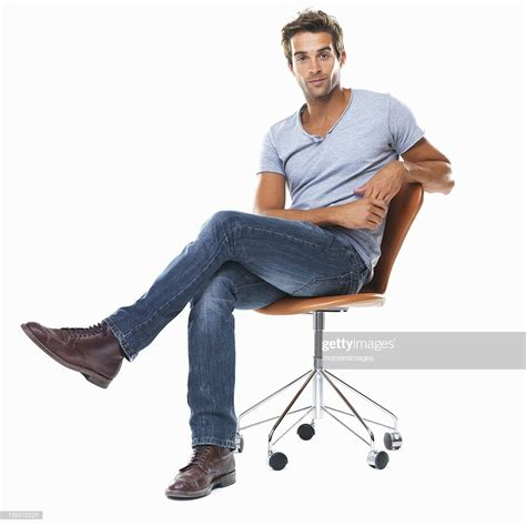 sitting on chairs portrait of sitting on chair with legs crossed