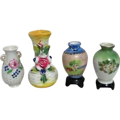 set of 4 miniature ceramic vases made in occupied japan