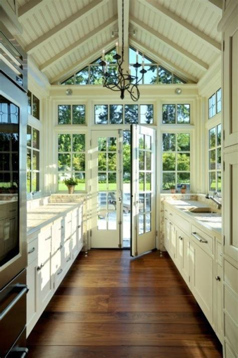 large windows open up a small kitchen lots of design meet style