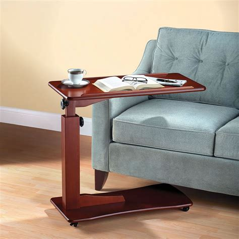 adjustable height end table the adjustable height side table hammacher schlemmer