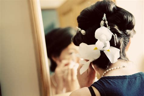 Wedding Hairstyles With Orchids by Wedding Updo Finished With Orchids And Stands Of Pearls