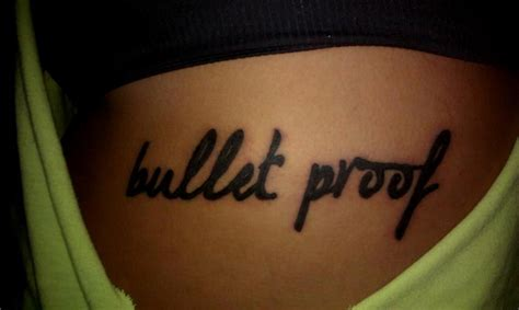 she s bullet proof tattoos peircin s