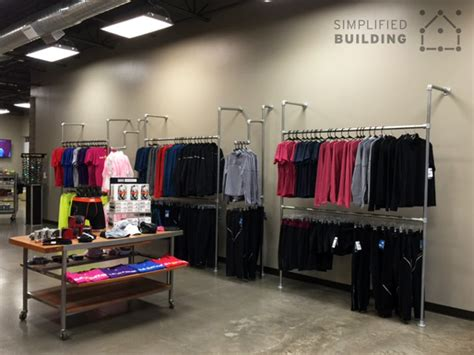 Wall Racks For Shops Wall Mounted Clothing Racks How To Use Them Effectively