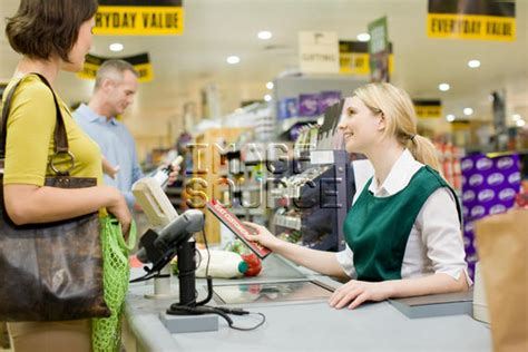 cashier and customers at supermarket checkout rf stock photo is098v381
