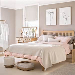 light pink bedroom bedroom with pale pink paint palette and wooden furniture