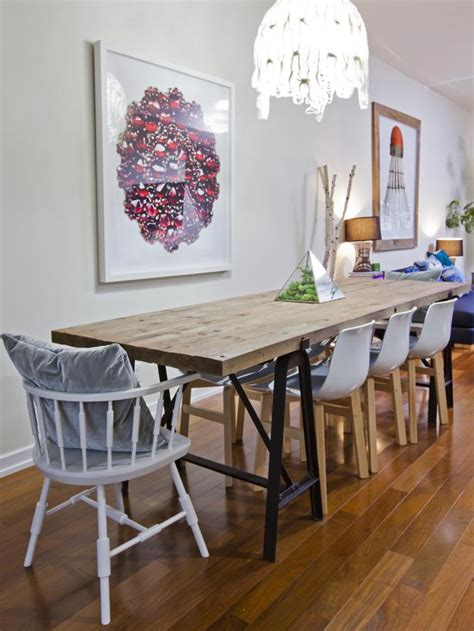dining area with rustic style wood table and modern chairs hgtv