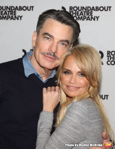 kristin chenoweth cuddles peter gallagher for on the photo coverage on the twentieth century meets the press