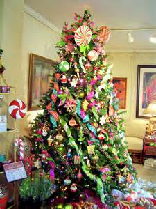 The candy theme christmas tree was decorated with all things sugarplum