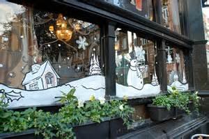 christmas stencils on a london pub all the windows had