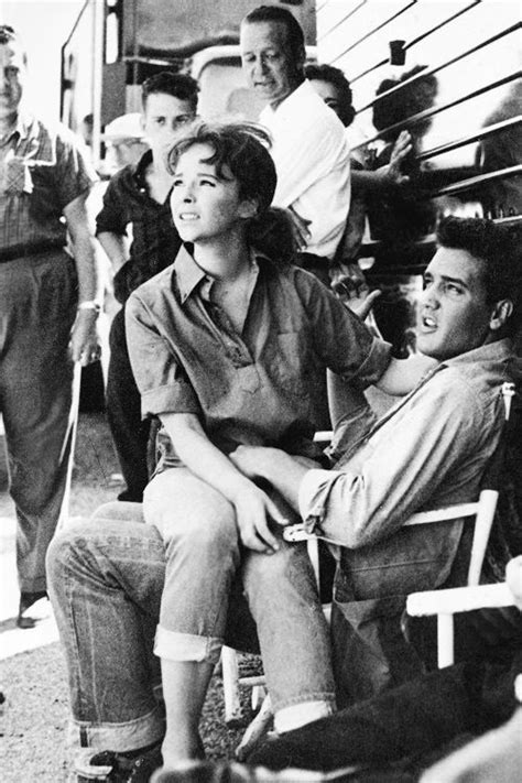 Elvis and actress Ann Helm between takes on the Follow