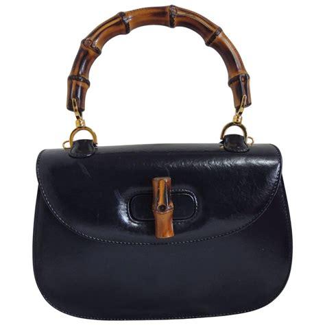 10 Gucci Handbags by Vintage Gucci Black Genuine Leather Handbag With Bamboo