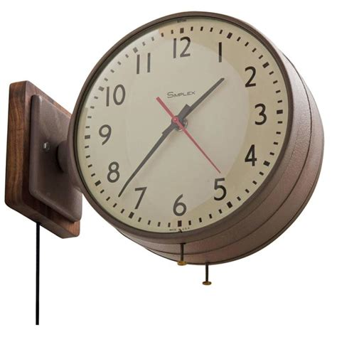 double sided simplex clock in brown with walnut backplate circa 1960s at 1stdibs