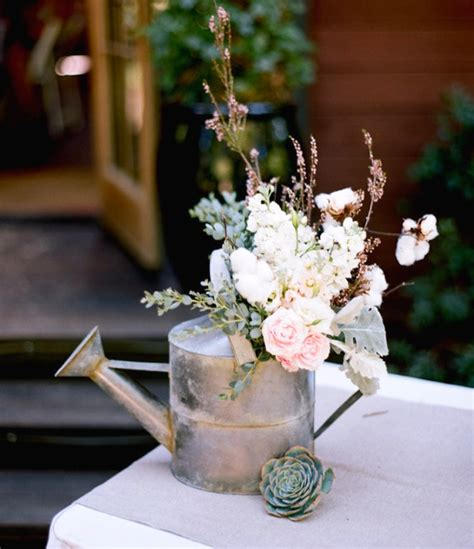 watering can centerpieces ingenious ways to upcycle watering cans