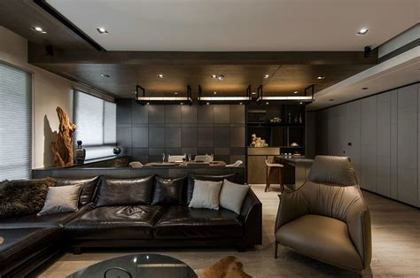 living designs stone and wood make a dark masculine interior