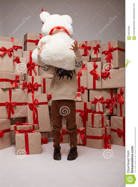 many gifts boxes with gifts covered with red satin and