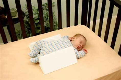 baby crib sleep positioner the myth of baby sleep positioners