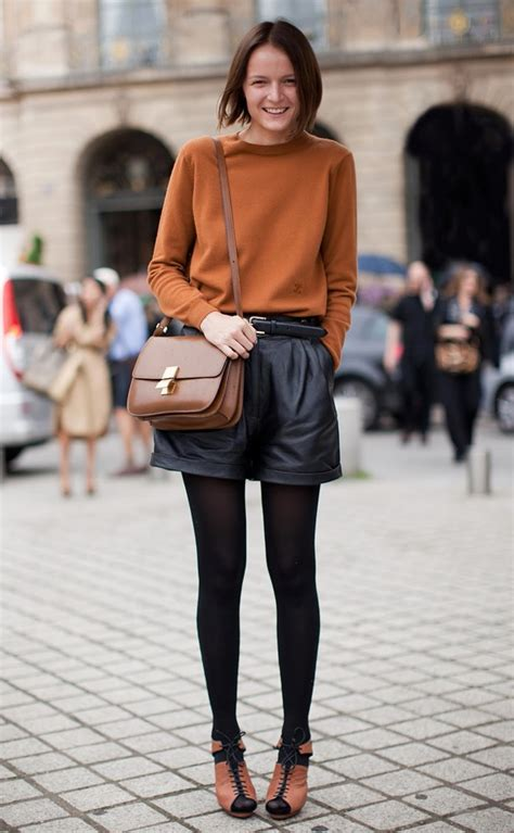 stockholm streetstyle black leather shorts black tights classic box bag camel sweater