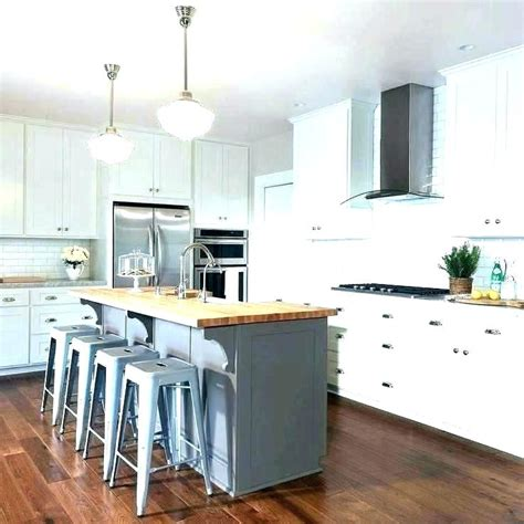 distressed kitchen island white cabinets with soapstone