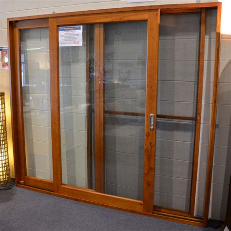 sliding doors sliding door solid cedar with flyscreen 2100 x 2100