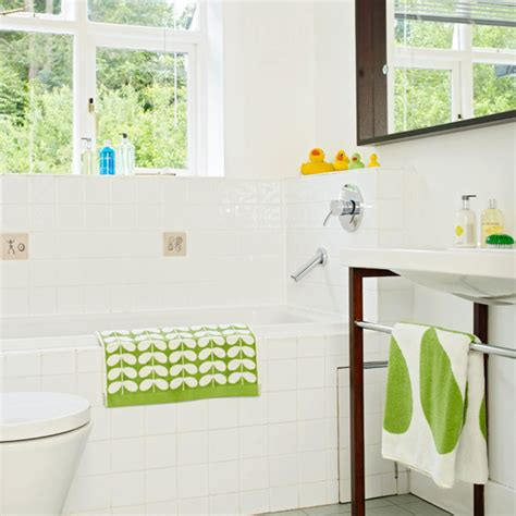green and white bathroom ideas white bathroom with green accents bathroom decorating