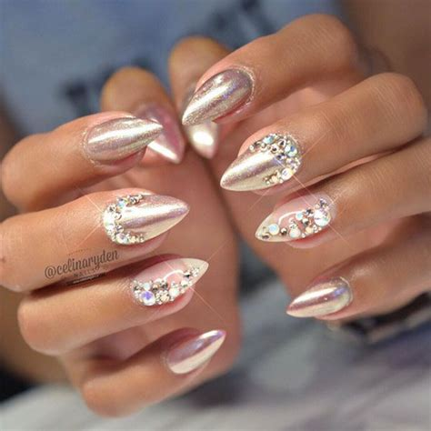 chrome nail art bedazzled chrome nude nails by celinaryden studs and