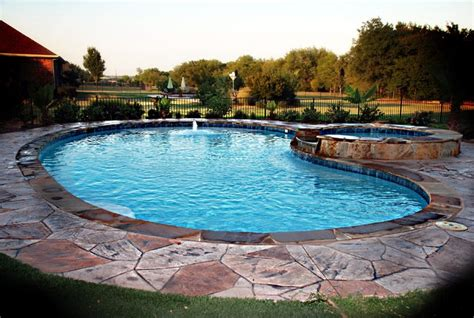 kidney shaped pools traditional kidney shaped pool with sted concrete deck