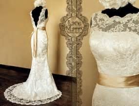 Deep v cut back vintage style lace wedding dress features illusion ne