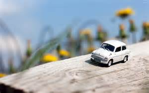 small wallpaper small car on a log wallpaper photography wallpapers 41641