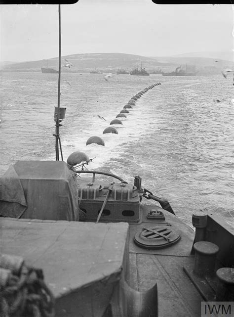 ROYAL NAVY VESSELS MAINTAIN THE BOOM DEFENCE AT SCAPA FLOW