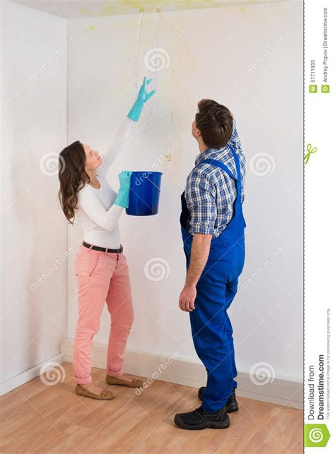 leaking ceiling stock images royalty free images housewife showing bucket royalty free stock photo