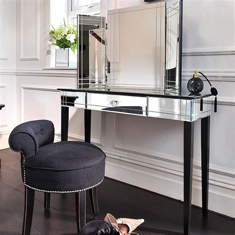 Mirrored Vanity Table Dressing Room Boasts Curved Built In Vanity Topped With Black Countertop And Folding Vanity