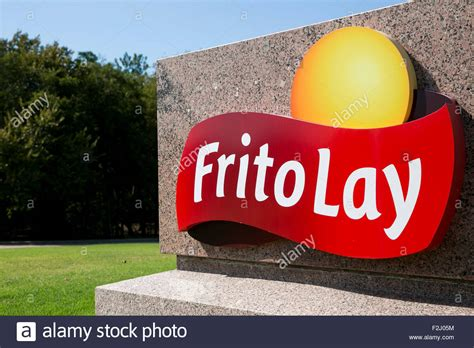 fruit o lay a logo sign outside of the headquarters of frito lay inc