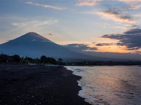 volcanic beach sunset on the beach over mt agung picture of volcano