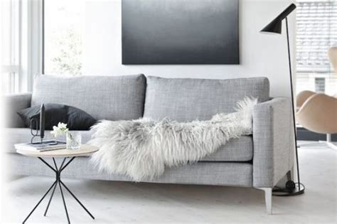 sheepskin rug on sofa sheepskins and sofas the perfect partners