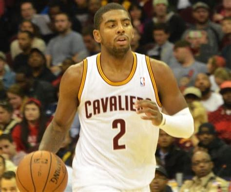 kyrie irving giving his chionship ring to his